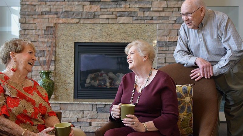 Group by fireplace in lounge