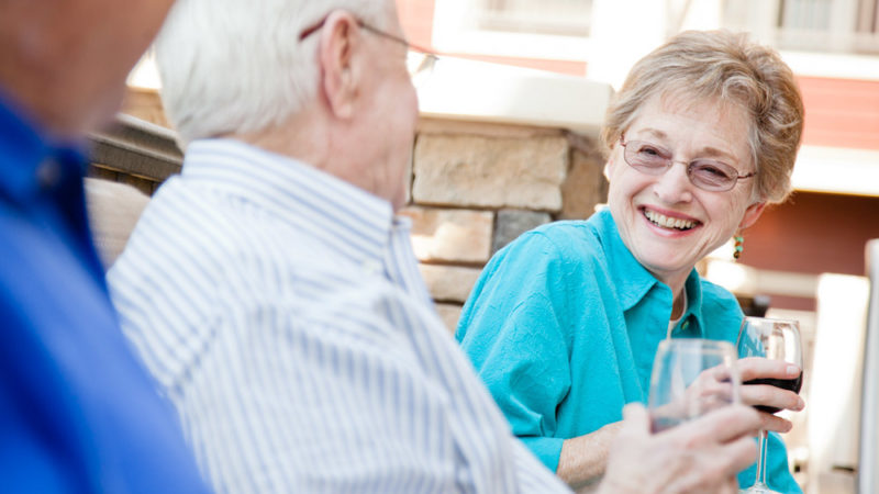 Residents Laughing Sharing Wine